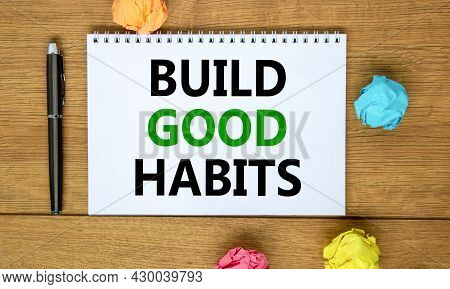 Build Good Habits Symbol. Words 'build Good Habits' On Beautiful Wooden Table, Colored Paper, Black