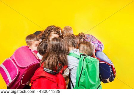 The Schoolchildren Are Stacking Hands Together At The Yellow Background