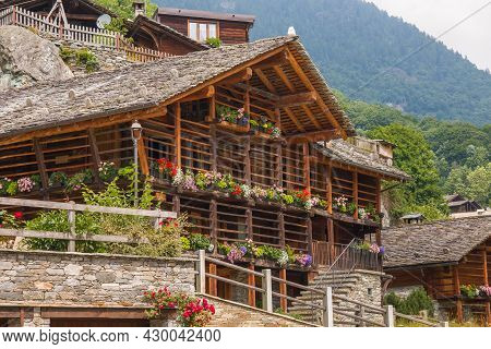 Flowering Balcony In The House Of Alagna Alpine Village At The Feet Of Monte Rosa, Valsesia, Piemont