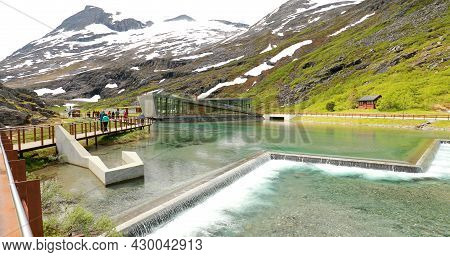 Trollstigen, Andalsnes, Norway. People Tourists Walking Visiting Viewing Platform Near Visitor Centr