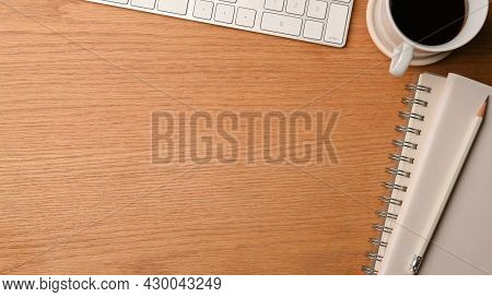 Wood Office Desk With Computer Keyboard, Notebook, Pencil, Black Coffee And Copy Blank Space