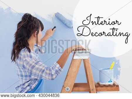 Composition of online crafting text over woman painting wall. crafting online promotional communication concept digitally generated image.