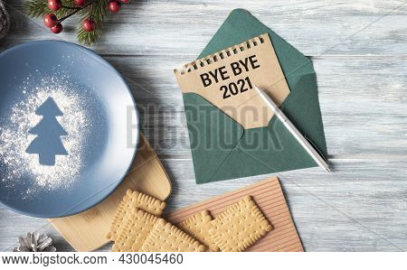 Happy New Year 2022 - Clips On Paper Envelope With Rope Lie On Wooden Table. Christmas Background. H