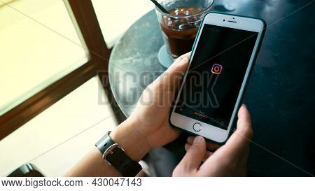 Chiang Mai, Thailand, August 1, 2021 On Holiday, Woman Using Instagram App On Apple Iphone Xi At The
