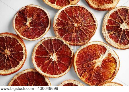 Dried Grapefruits And Oranges In Slices On A White Background. Grocery Background Of Dried Citrus Sl