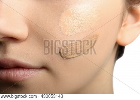 Girl On White Background, Closeup. Using Concealer And Foundation For Face Contouring