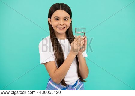 Be Hydrated. Kid Hold Glass Of Water. Child Feel Thirsty. Teen Girl Going To Drink Mineral Beverage.