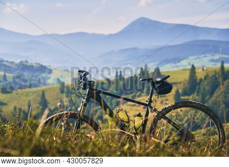 Picturesque Snapshot Of Bicycle In The Mountains. Beautiful Natural Landscape: Mountain Peak, Green