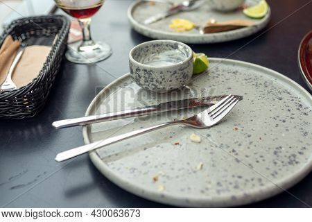 Three Empty Plates After Meal Is Finished, With Forks And Knives. Dirty Plates After Dinner Finished