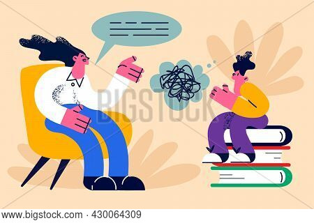Educational Process, Learning, Knowledge Concept. Young Smiling Woman Mother Or Teacher Sitting And