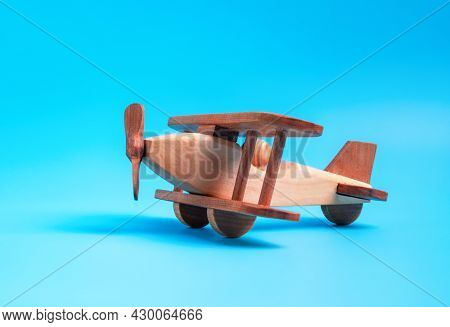 Wooden Toy Airplane Biplane On A Blue Background