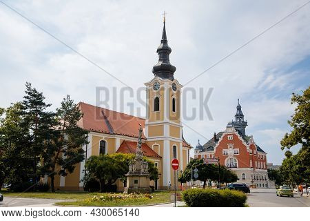 Hodonin, South Moravia, Czech Republic, 03 July 2021: Baroque Church Of St. Lawrence And Town Hall W