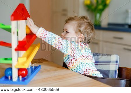 Little Baby Girl Playing With Educational Toys At Home Or Nursery. Happy Healthy Toddler Child Havin