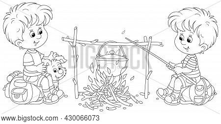 Little Boy-scouts With A Small Pup In A Forest Camp, Friendly Smiling, Talking And Cooking Tasty Sou
