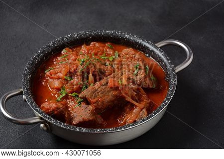Beef Meat Stew. Overhead View Braised Beef Meat Stew In Tomato Sauce With Herbs