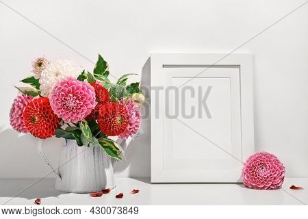 Mockup With Photo Frame And Autumn Dahlias Flowers Bouquet On White Table. Wall Table Background, Tr