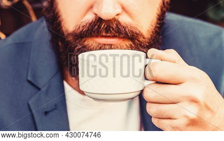Coffee Drink. Bearded Man, Hands Holding A Hot Coffe Cups. Coffe Time