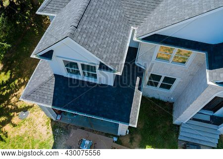 Rooftop In A New Home Constructed Showing Asphalt Shingles Multiple Roof Lines With Aerial View