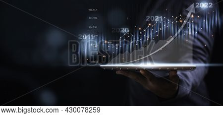 Businessman Or Trader Showing Glowing Virtual Technical Investment Graph Chart For Analysis Stock Ma
