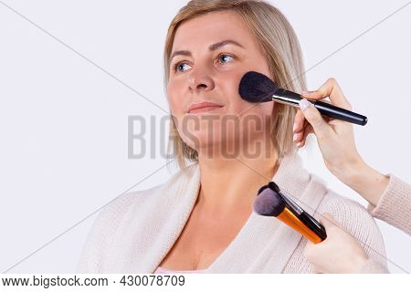 Business Pretty Blond Woman With Light Complexion Gets Makeup For Preparing For Business Meeting.