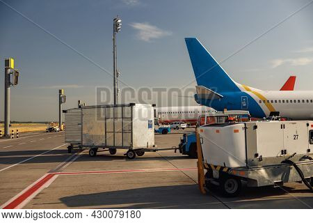 Airfield Tractors Near Big Modern Airplane. Preparation Of Aircraft For Boarding In Airport Hub On A