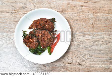 Spicy Stir Fried Crispy Catfish Curry With Basil Leaf On Plate