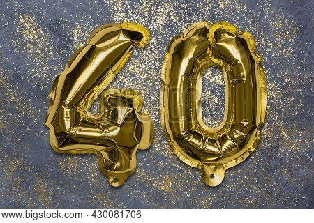 The Number Of The Balloon Made Of Golden Foil, The Number Forty On A Gray Background With Sequins. B