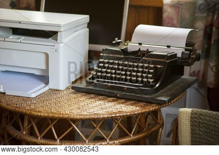 A Workplace With Vintage Typewriter And Modern Scanner, Concept Of Bureaucracy