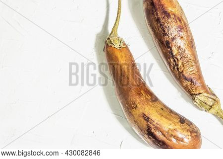 Decayed, Rotten Eggplant. Old Vegetables With Mold