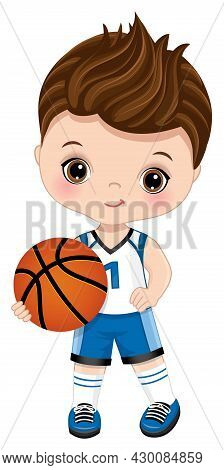 Cute Little Boy Wearing Blue And White Sport Outfit Playing Basketball. Little Boy Is Cute And Brune