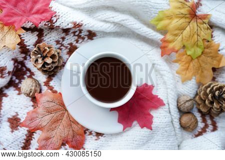 Autumn Composition With Hot Cup Of Coffee With Scarf, Nuts And Leaves. Concept Of Cozy Morning, Comf