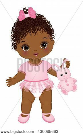Cute Black Baby Girl Wearing Pink Ruffled Dress. African American Baby Girl Holding Bunny Toy. Baby