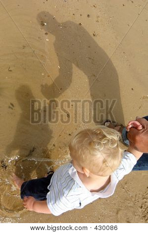Little Boy With His Grandad On The Beach