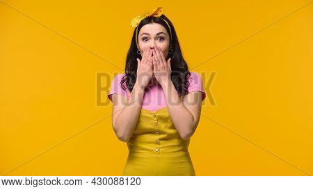 Astonished Woman Looking At Camera Isolated On Yellow.