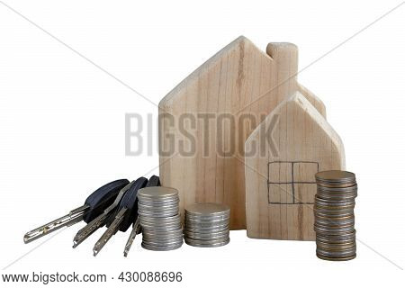 Concept Buying New Home. Wooden Houses, Stacks Coins, House Keys Isolated On White. Search Rental Re