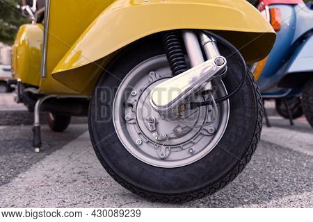 Close Up Of The Tire Of A Vintage Italian Scooter, Symbol Of Italian Design. High Quality Photo