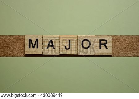 Gray Word Major From Small Wooden Letters On A Green Table