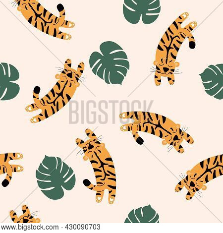 Vector Seamless Pattern With Spotted Tigers.  Tigers On A Beige Background Are Jumping Into Palm Lea