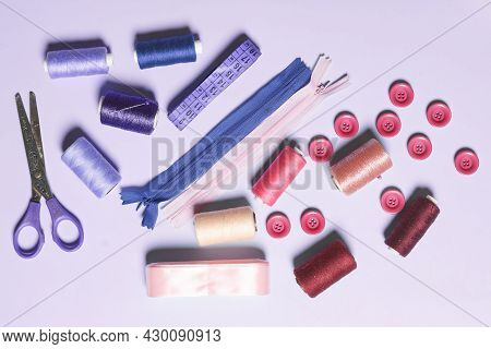 Sewing Items From Above. Flat Lay Composition With Sewing Accessories On Light Color Background. Ite