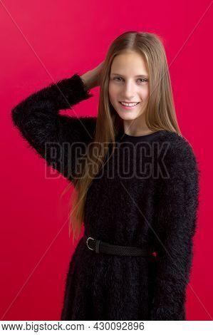 Beautiful Teenage Girl Touching Her Long Hair. Portrait Of Charming Smiling Teenager Wearing Black S
