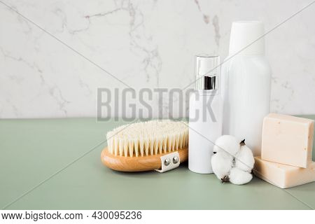 Empty White Cosmetic Containers, Jars, Body Brush And Soap On The Bathroom Shelf. A Set Of Cosmetics