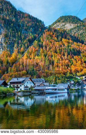 Austrian tourist destination Hallstatt village on Hallstatter See lake lake in Austrian alps with tourist boat. Salzkammergut region, Austria