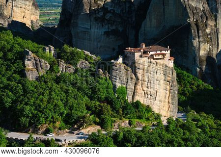 Monastery of Rousanou in famous greek tourist destination Meteora in Greece on sunset with scenic landscape.