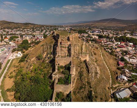 Georgiean Flag Over Walls Of Gori Fortress. Goris Tsikhe Is A Medieval Citadel Standing Above City O