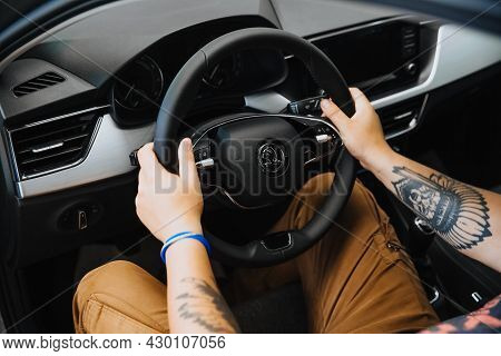 Zaporozhye, Ukraine- July 03 2020 : A Mans Hand Holds The Steering Wheel Of A Car.