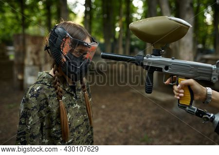 Shot from paintball gun in the girl's face in mask