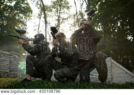 Paintball team, battle on playground in the forest