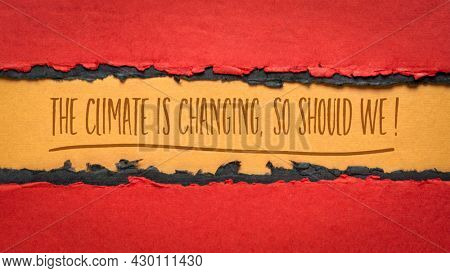 The climate is changing. So should we! Handwriting on red and orange handmade paper, global warming concept