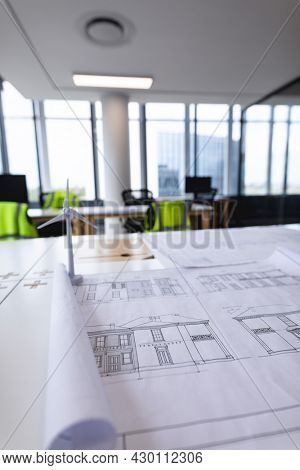 Interior of empty modern office with desks and drawings. modern office of a creative design business.