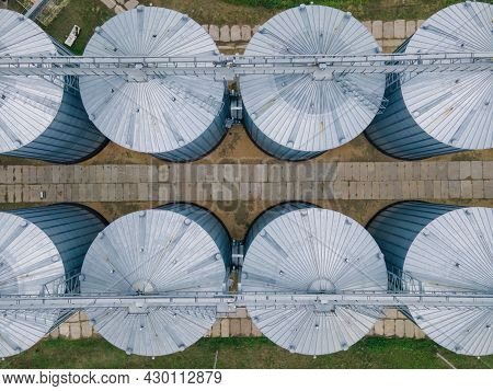 Grain Storage In Large Silos Aerial View. Silo With Grain. Grain Storage Tank View From Above